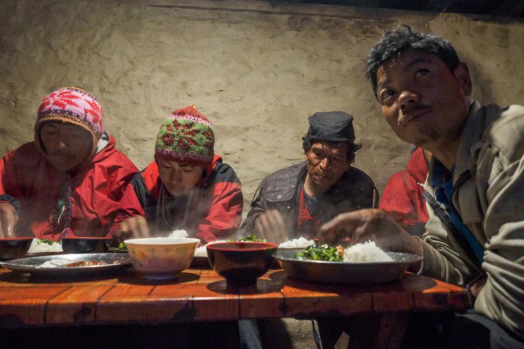 porters having dal bhat for dinner