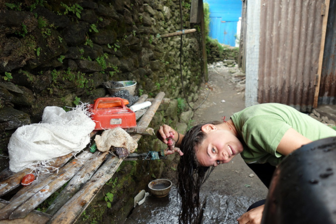 Washing my hair in Khebang.