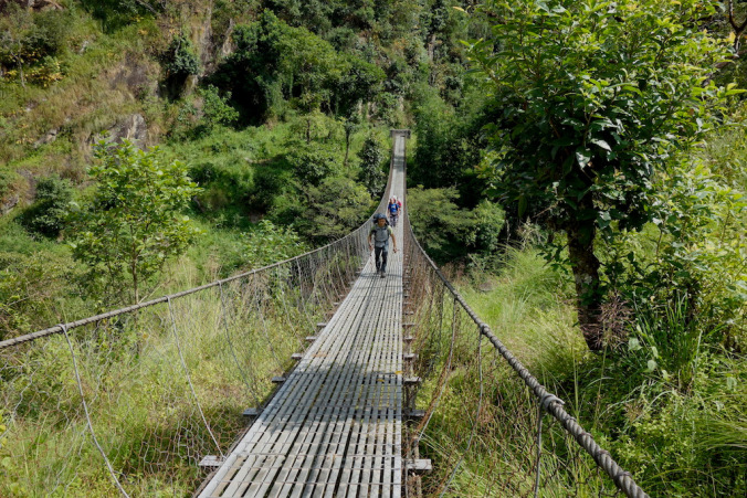 suspension bridge tamo nadi river valley
